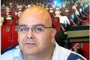 יובל וגנר, יושב ראש נגישות ישראל, ברקע: אולם קולנוע