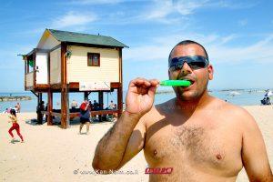 מזג האוויר היום בכל רחבי הארץ: עומס חום כבד ומסוכן לבריאות | מציל בחוף הים | צילום: Pixabay | עיבוד צילום: שולי סונגו ©