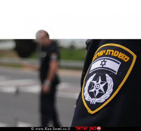 שוטר משטרת ישראל בצילום מטושטש | צילום דוברות המשטרה | עיבוד צילום: שולי סונגו