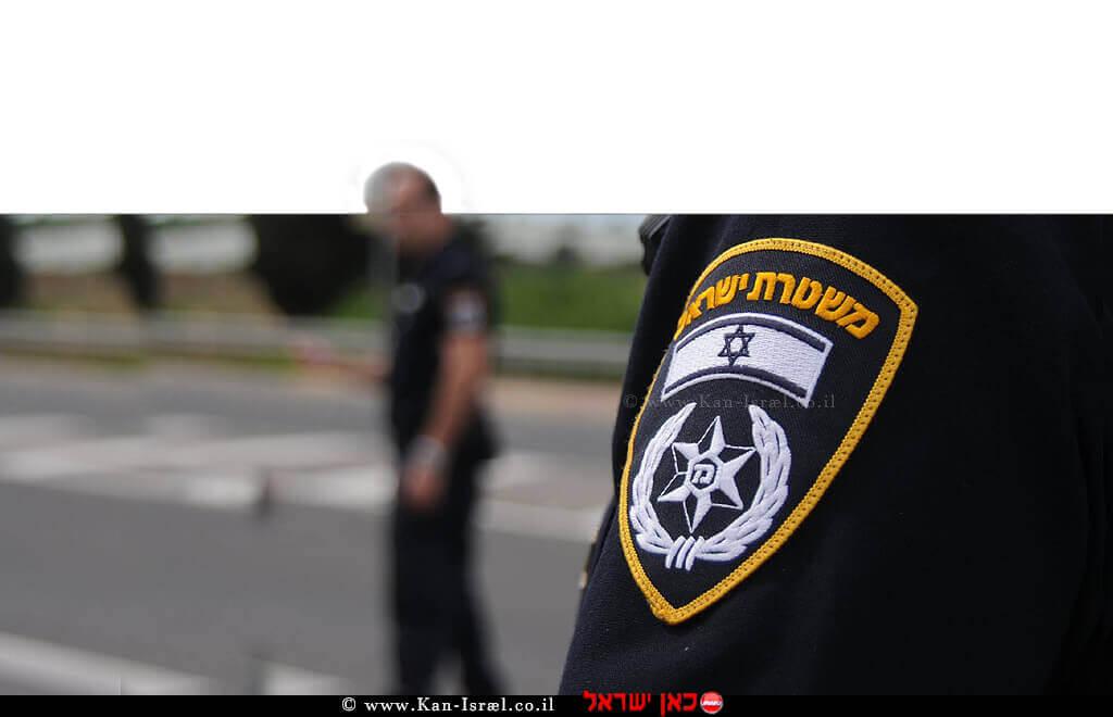שוטר משטרת ישראל בצילום מטושטש   צילום דוברות המשטרה   עיבוד צילום: שולי סונגו