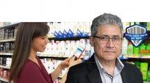 עורך דין מיכאל אטלן, הממונה על הרשות להגנת הצרכן ולסחר הוגן, ברקע הצגת מחיר מוצר על גבי צג אלקטרוני | עיבוד צילום: שולי סונגו
