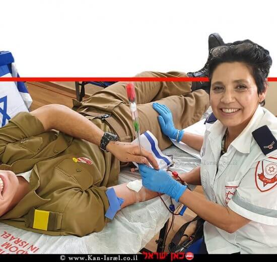 גב' מיכל פריד אפרתי מהוד השרון, מתרימת דם במדא עם התורם החייל רועי פריד, בנה