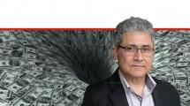 עורך דין מיכאל אטלן הממונה על הרשות להגנת הצרכן ולסחר הוגן ברקע בור של דולרים | עיבוד צילום: שולי סונגו ©