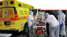 צוותי מדא מתמגנים מ'הקורונה' בחליפות מיגון - צילום דוברות מדא - פברואר 2020 | עיבוד ממחושב: שולי סונגו©