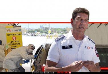 אלי בין, מנכל ארגון מגן דוד אדום בישראל (מדא) ברקע: תחנת 'היבדק וסע' לבדיקת קורונה | עיבוד צילום: שולי סונגו ©