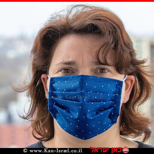 אישה עם מסכה נגד מחלת נגיף קורונה covid-19 | עיבוד צילום: שולי סונגו ©