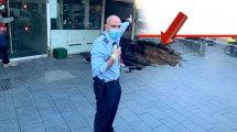 קצין משטרה ירושלמי מכוון את הציבור להתרחק מהבולען שנפער בחנות ברח' הלל בעיר ירושלים לחניון שמתחתיה | צילום: דוברות המשטרה |עיבוד צילום: שולי סונגו ©