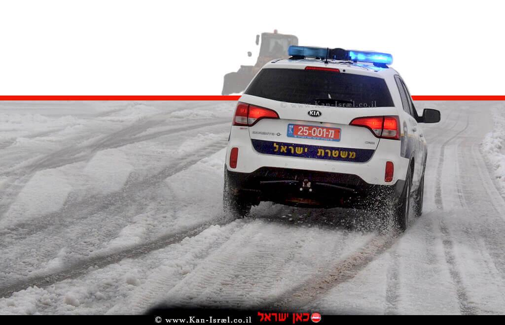 ניידת של משטרת ישראל בעת שלג ומזג אויר סוער | צילום דוברות המשטרה ארכיון | צילום: דוברות המשטרה |עיבוד צילום: שולי סונגו ©